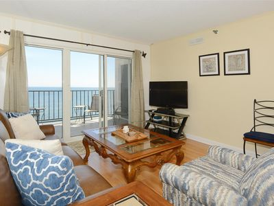 Photo for FREE DAILY ACTIVITIES! Beautifully decorated, direct oceanfront 2-bedroom, 2-bath condo with an open den.