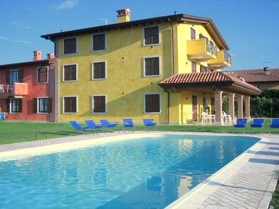Photo for Renovated farmhouse uniquely situated on lake Garda