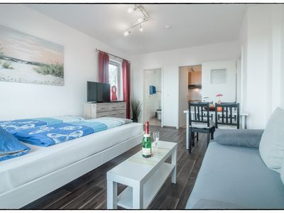 Photo for Non smoking apartment for 3 adults or 2 adults + 2 children. direct beach location