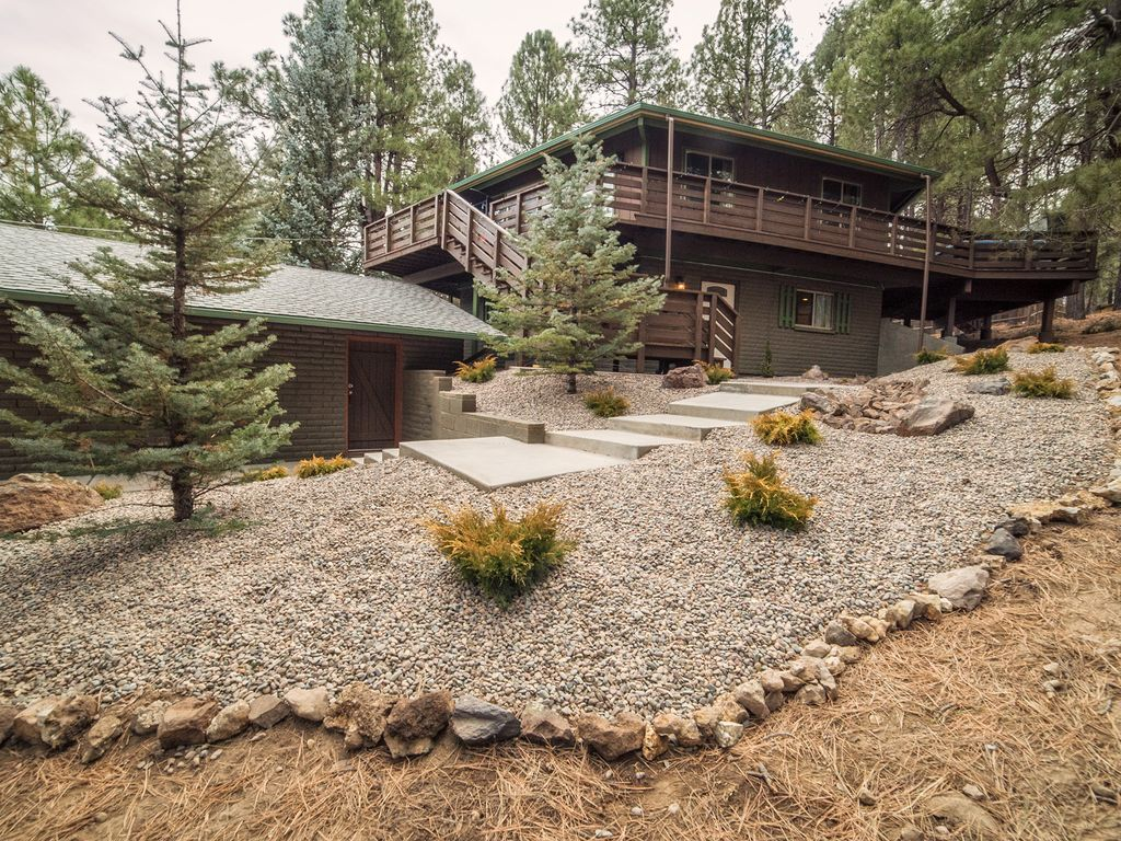 nestled cabin tall cabins s home flagstaf yards flagstaff luxury beach in the bed ha deal lodge property conservation pines from area image rentals little elk