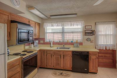 Fully equipped kitchen, refrigerator, dishwasher, oven/stove, microwave, toaster oven, blender and coffee maker.