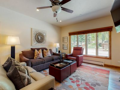 Photo for Homey ground floor ski-in/ski-out condo w/ patio & shared pool and hot tub!