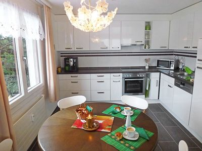 Photo for Apartment in the center of Emmetten with Parking, Internet, Washing machine, Garden (46587)