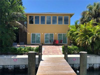 Photo for Direct Water View 2 bedroom 1 bath In John's Pass Village w/ 24' dock (no trailer parking).