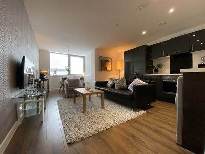 Photo for Fantastic brand new apartment  with river and city views Minute  from seafront