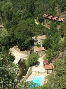Photo for 6 quiet chalets, swimming pool and river in Ardèche