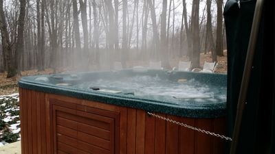 Enjoy the Hot tub over looking woods and mountain in the back yard