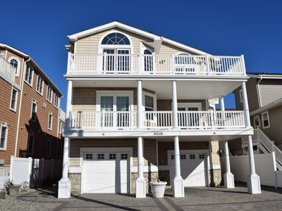 AMAZING OCEAN VIEWS from this beautiful 5 bedroom townhome with elevator, located 1 off the beach!