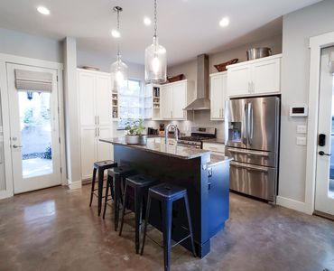 Bright, open kitchen with all the creature comforts and bar seating for 4