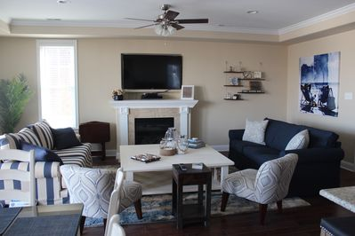 """Living area has 55"""" tv, large coffee table, two queen sleeper sofas and more"""