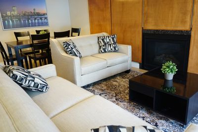 """Living room with gas fireplace and 48"""" smartTV."""