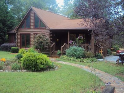 Photo for River front log home 3 miles from Tryon Equestrian Center, gated community