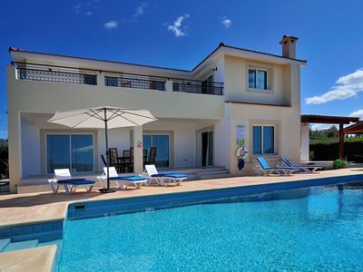 Photo for This 4-bedroom villa for up to 8 guests is located in Coral Bay and has a private swimming pool, air