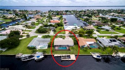 Photo for Fantastic Property with heated pool on saltwater canal, minutes to the Gulf