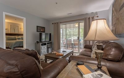 Photo for A cozy, quaint condo with an inviting screened patio!
