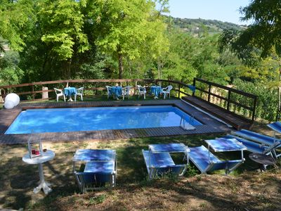 Photo for Relax in the Romagna hills, apartments in the green.