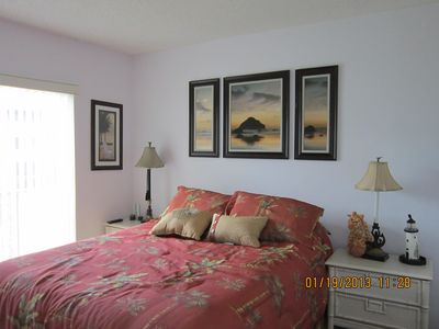 2nd Bedroom, has a queen bed, and 2 nightstands. Comfy Tommy Bahama comforter.