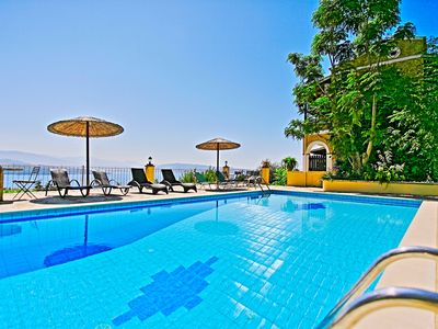 Photo for Beautiful villa with private pool set close to Saint Stefanos and Kerasia Beach