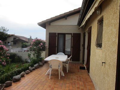 Photo for 300m from the beaches, nice terraced house with its own garden