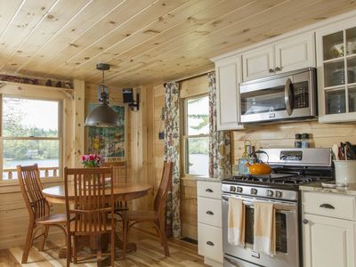 Photo for Luxury Log Cabin Lake Winnisquam pvt beach, boat slip,outdoor kitchen, fire pits