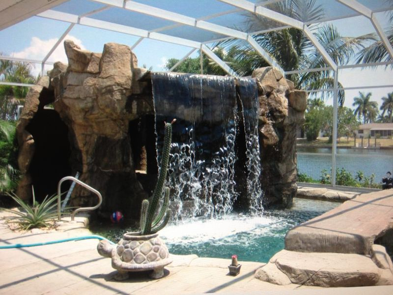 Water Park Style Pool With Hot Tub In Grotto W Waterfall