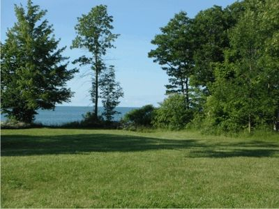 large open yard for games and bon-fires above the shoreline