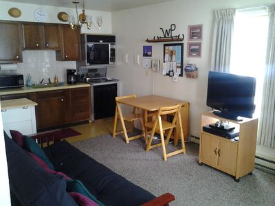 Drop-leaf table, 4 chairs, oven, stove top, dishwasher, microwave & coffeemaker.