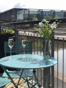 Photo for Stylish canal side city apartment, perfect location & free secured parking,