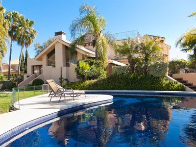 Photo for Luxury modern villa with heated pool & garden, 15 minutes walk to beach in El Rosario, Marbella