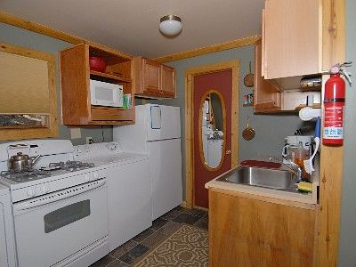 Fully Equipped Kitchen with Large Frig Gas Range, Microwave, Coffee Maker, Etc.
