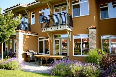 Tuscan style architecture-earthy colors with wrought iron details.