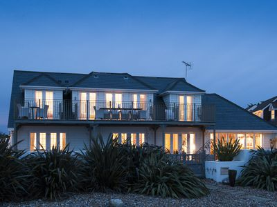 Photo for Stunning beach front property with sea views and hot tub featured in Tatler