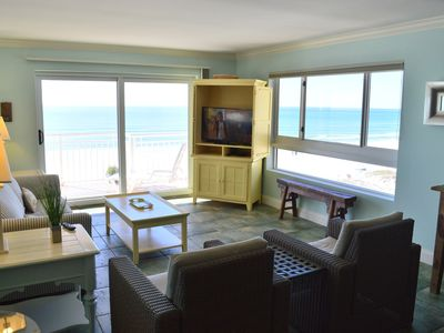Photo for Watch 🐬🌊🐬 From the Balcony🌞🌊Beachfront✔️🌊Middle Unit✔️✔️ Updated✔️✔️✔️