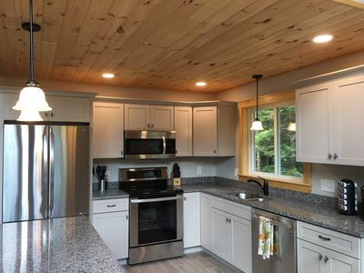 Kitchen with granite countertops and island