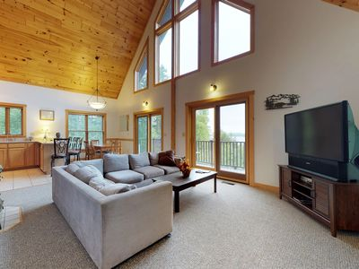 Photo for Beautiful cabin w/ modern amenities, furnished deck, and spectacular lake view