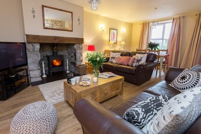 Open plan living with multi fuel stove. Chose from 1000's films with Sky Movies