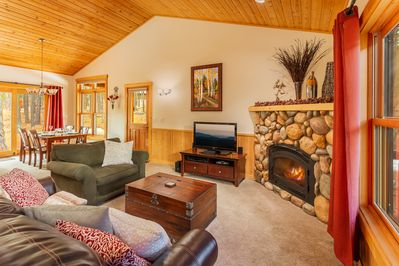 Living room with high ceiling and gas fireplace