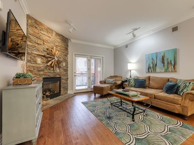 Photo for Polished downtown condo w/ jetted tub, fireplace & shared hot tub/pool!