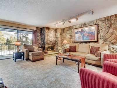 Photo for Stone fireplace, balcony with mountain and lake views. Clubhouse with pool and hot tubs.