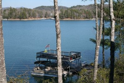 Catch a view of beautiful Lake Keowee, our dock and the N. C. mountains.