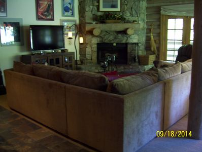 Living area with french doors to deck that over looks ski lift