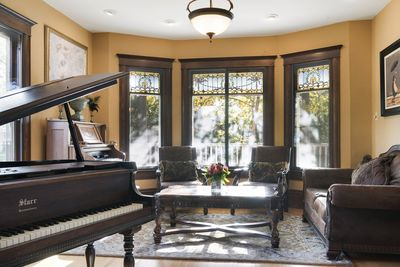 Music room: Baby grand piano, Antique pump organ, Guitars & other instruments