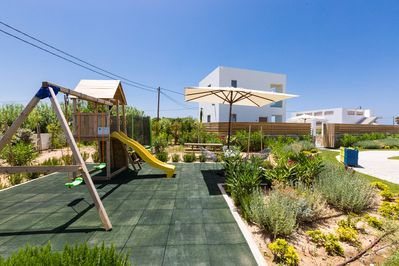 Safe playground area for young children with toys, table tennis & trampoline