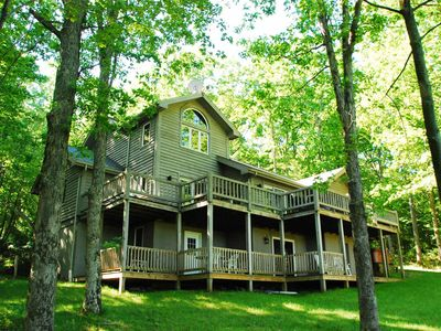 Nestled amoung trees w/ lake access, large spacious decks, & fenced in yard for dogs!