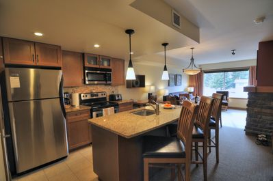 Spacious kitchen with essential kitchen tools.