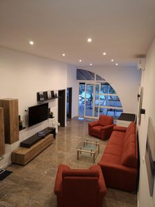 Photo for Ground floor 6 + 2 P apartment with terrace and sea view, 10 m from the beach