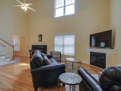 Open and airy living area complete with Yamaha U1 piano