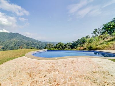 Photo for Secluded house on hilltop w/ infinity pool & stunning jungle views