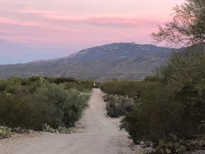 Sunset over the Rincon mountains looking down the road to the house