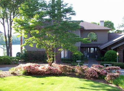 Front of House with Azaleas in bloom and Lake in background